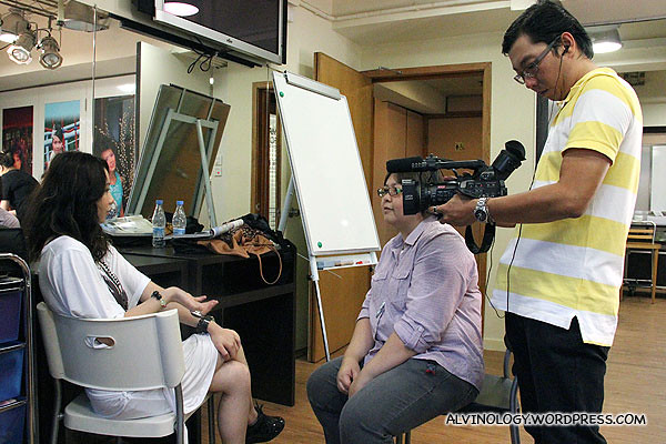 My colleague, Siew Kian, interviewing Celia Wong while waiting