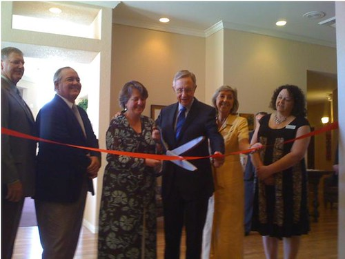 From Left to Right:  Lakeview Terrace Owners Gary Lanzen and Allan Richardson are joined by Deputy Secretary Kathleen Merrigan, U.S. Senator Harry Reid, Congresswoman Dina Titus, and Lakeview Terrace General Manager Teri  Stoneback in cutting the ribbon at the Grand Opening Celebration.