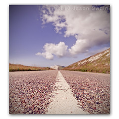 TGIF. The weekend is in sight ( A3055 Military Road Vertorama ) (s0ulsurfing) Tags: road uk blue light summer england sky cliff cloud sunlight blur english grass lines weather tarmac clouds composition rural canon vintage skyscape island coast chalk focus skies britain pov patterns wide perspective blues wideangle august cliffs nostalgia coastal vectis isleofwight cumulus convergence coastline british roadside tgif isle vignette depth wight foreground 2010 converge verge expanse whitelines westwight 10mm coastroad leadinglines freshwaterbay tennysondown sigma1020 tarmacadam militaryroad s0ulsurfing asphaltconcrete vertorama a3055 bituminousasphaltconcrete welcomeuk
