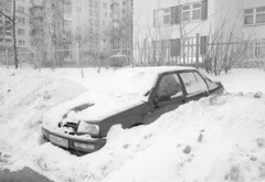 Untitled-16 (Evgeny Chulyuskin) Tags: winter blackandwhite bw snow film car 35mm trapped stuck under captured ps covered yashicat5 yashica compact t4 illfordhp5plus400