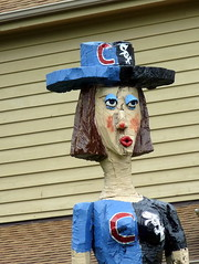 Treesa won't commit. (yooperann) Tags: blue sculpture woman tree art hat shirt america wooden carved grove folk large chainsaw trunk cubs roadside eyeshadow whitesox fairview downers chicagoist orticelli