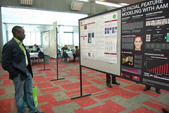 Ade Olubummo studying Stanford 3D Vision Lab's motion detection research poster board