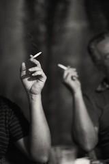 smokers-II-b-w (MEDIAVITA) Tags: friends night noche fiesta bokeh availablelight cigarette jardin atmosphere manos patio tenerife 100 f2 talking smokers humo zuiko charla cigarrillo fumador brazos privat 100f2 100mmf20 zuiko100f2 canoneos5dmkii omzuiko100mmf20