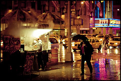 The Aroma of a Rainy Midtown Night (RBudhu) Tags: nyc newyorkcity reflection rain umbrella rockefellercenter midtown gothamist radiocity streetvendor foodvendor streetmeat foodcart midtownmanhattan midtownlunch rainynyc halalcart radiocityconcerthall