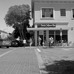 Walking Through the Peet (Let There Be More Light) Tags: california ca street blackandwhite bw brick 120 6x6 tlr mediumformat square shanghai mat 124g analogue crosswalk burlingame rodinal yashica peets 80mm gp3