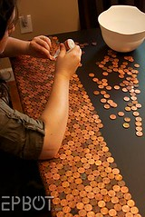 Penny-covered desk maker