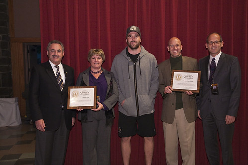 USDA staff present the Vikings and Second Harvest Heartland with Certificates of Appreciation From left to right, Vikings owner Zygi Wilf, USDA's Julie Mikkelson, Vikings player Jared Allen, Second Harvest Heartland Executive Director Rob Zeaske, and USDA's Alan Shannon.