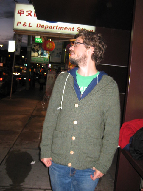 an ugly green sweater, complete with giant pockets and elbow patches