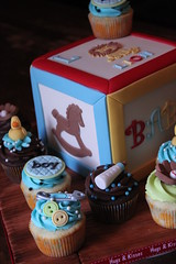 Building block cake with matching cuppies (Andrea's SweetCakes) Tags: wood boy cake cupcakes bottle buttons lion ducky rockinghorse babyshower safetypin baseballglove buildingblock