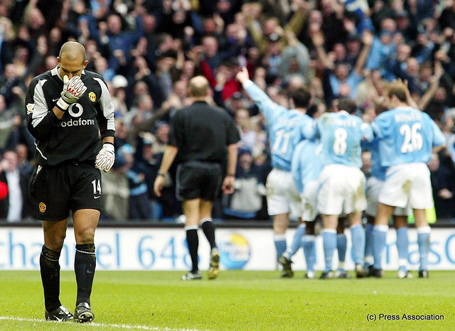 Shaun Wright-Phillips, scorer of Citys fourth against United in March 2004 celebrates with his team mates