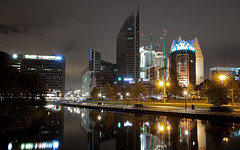 The Hague City @ Night (DolliaSH) Tags: city longexposure light holland water station skyline architecture night train canon reflections photography lights photo topf50 nightshot photos thenetherlands trails railway denhaag relection nightscene centraalstation topf100 torens thehague modernarchitecture architettura stad 1022 afterdark architectuur citylight zuidholland canonefs1022mmf3545usm ministerie binnenstad overheid sgravenhage nachtopname modernearchitectuur architetturamoderna canoneos50d haagsetieten dollia dollias sheombar dolliash dedicatedtomyflickrfriendsinthehague