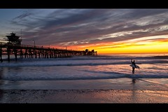 sunset surfer (Eric 5D Mark III) Tags: ocean california sunset sky people cloud seascape color beach canon landscape pier twilight surfer wave atmosphere orangecounty sanclemente tone ef1635mmf28liiusm eos5dmarkii