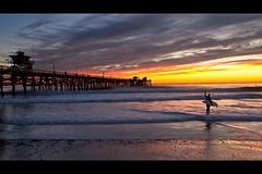 sunset surfer (Eric 5D Mark III) Tags: ocean california sunset sky people cloud seascape color beach canon landscape pier twilight surfer wave atmosphere orangecounty sanclemente tone ef1635mmf28liiusm eos5dmarkii
