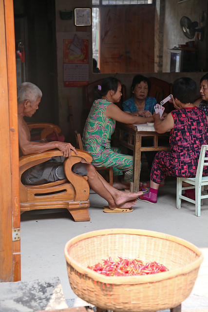 People playing card game in Xingping, Guangxi, China