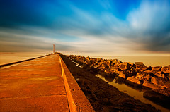 End Of The Road (DolliaSH) Tags: longexposure blue red sea sky seascape holland color beach water clouds strand canon pier topf50 rocks nederland thenetherlands noordzee le slowshutter topf150 topf100 zuidholland 1755 hoekvanholland southholland 2000views 50d canonefs1755mmf28isusm nd110 canoneos50d dollia dollias sheombar dolliash bw10stopsolidndfilter