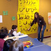 Students from the Islamic Culture Club at St. Lawrence University teach children at the Unitarian Universalist Church of Canton how to spell their names in Arabic script. Photo: Gina Nicoletta-Budler.