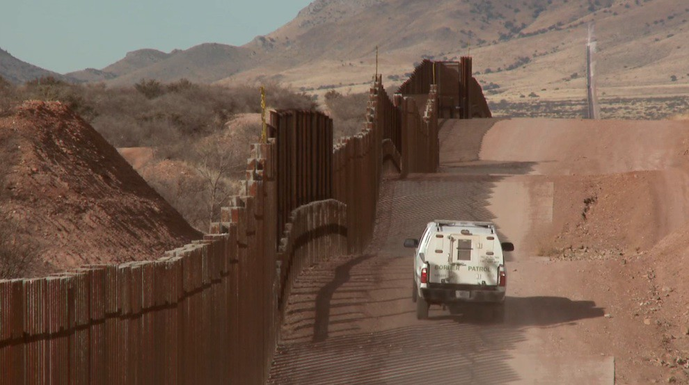 Border patrol at US-Mexico Wall in desert