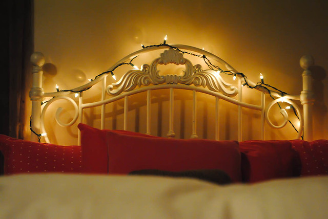 christmas light wrapped headboard