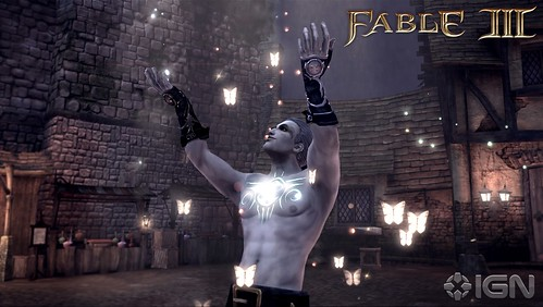 A screencap from Lionhead Studio's Fable III of a male playable character standing in a dirty industrial looking city. The character is shirtless, with his arms raised over his head. His skin is extremely pale, and his chest tattoo glows with bright lights. There are glowing butterflies all around him.
