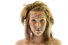 Tribal Look (Voyage Images) Tags: color girl face hair photography crazy rainbow rachel paint indian avatar tribal blond blonde swirl swirls lynne genel glphotography genellynne