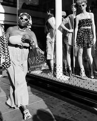 Sister's in shades (Ian Brumpton) Tags: street blackandwhite bw blancoynegro monochrome blackwhite candid explore citystreets westend biancoenero oxfordcircus decisivemoment walkingwithpurpose lifeinmotion sidewalkstories explored blackwhitephotos londonstreetphotography scattidistrada aimlessstrolling blackwhiteheartbeats sistersinshades sunglassesbeforedark