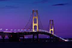 """Twilight""   at Mackinac Bridge, Mackinaw City, Macinac Island -  ""Michigan Nut Photography"" (Michigan Nut) Tags: longexposure nightphotography sunset usa st geotagged gold lights golden nikon ship dusk michigan bridges lakemichigan explore colored colorfullights nautical suspensionbridge recent channel lakehuron mackinacbridge stignace purplesky ignace mackinawbridge mackinawcity macinacisland mackinacislandferry d700 fortmacinac straitsofmacinac michiganbridges ringexcellence dblringexcellence michigannut"
