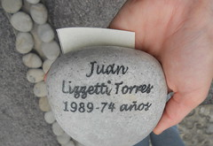 Stone with the name inscribed of a victim from Peru's conflict