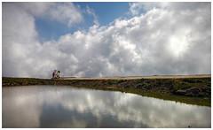 On the edge of the sky - Al bordo del cielo (Robyn Hooz) Tags: sky mountain lake reflection ex bike clouds canon italia nuvole sigma verona monte polarizer 1020 malcesine laghetto veneto montebaldo baldo polarizzatore hsm 550d rifless mywinners