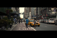 Killer bees (Dj Poe) Tags: street new york city nyc cinema ny macro bus station yellow canon eos dj crossing mark manhattan district candid taxi 100mm midtown ii crop lane penn 5d usm cinematic tones poe 34th f28 2010 garment 5dmkii 5dmk2