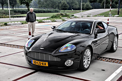 Aston Martin V12 Vanquish (Thomas van Rooij) Tags: park lighting street old city light people man black holland color reflection classic beautiful dutch face lines car metal photography design amazing cool nice rotterdam nikon view angle body thomas expression milano awesome side curves great engine nederland style automotive front event exotic chrome hood surprised headlight grille gt nikkor rim rims executive coupe supercar rolling vr astonmartin ahoy sportscar 2010 v12 vanquish 18105 60l d90 rooij worldcars maartenmemorial powerbeautysoul thomasvanrooij