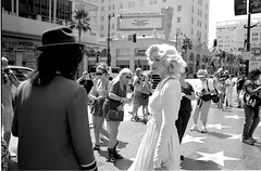Hollywood Boulevard #7 (stillsguy) Tags: street leica trees light summer bw 35mm kodak tmax f14 marilynmonroe crowd profile palm well socal 400 michaeljackson hollywoodblvd stores angular summilux asph m7 impersonators wishers hollywoodchapter