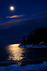 Night Light (photo.klick) Tags: blue light usa cloud moon lake cold reflection ice water minnesota night photoblog northshore upnorth mn grandmarais katsingercom
