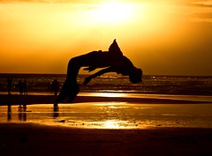 (bliss.sid) Tags: ocean sunset red sky orange sun sunlight beach water silhouette yellow skyline clouds canon rebel high sand dusk air horizon h2o midair gokarna karnataka soar xsi 450d canon450d