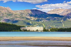 Fairmont Chateau Lake Louise (Jim Boud) Tags: travel blue mountain lake canada mountains reflection green nature water pinetree clouds canon lens landscape outdoors eos hotel is nationalpark sand colorful paradise peace shadows hill smooth relaxing turqouise rocky peaceful wideangle canadian lodge canoe shore alberta valley northamerica banff usm dslr lakelouise chateau 1785mm digitalrebel relaxed photoart digitalslr pinetrees efs1785mmf456isusm province firtree waterscape artisticphotography partlycloudy canadianrockies fairmontchateau glacialvalley photomatix imagestabilization imagestabilized 550d jimboud t2i exposurefusion jamesboud eos550d kissx4