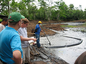 <B>Rep. Jim McGovern observes the cleaning of an oil spill</B>