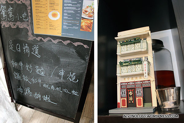 Paper replica of the exterior of the restaurant building and the menu board