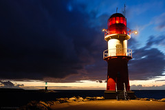 Windy Evening in Warnemnde (Dietrich Bojko Photographie) Tags: light sea lighthouse d50 germany deutschland evening abend warnemnde meer wind nikond50 dri rostock mecklenburgvorpommern lichtturm mywinners hohedne infinestyle tokina1224atx dietrichbojko baltissea globalindex mygearandmepremium osetsee