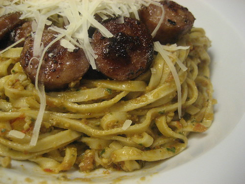 Linguini with tomato pesto and sausage