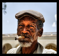 Lovely Portrait (Polis Poliviou) Tags: portrait people man eye face hat shirt museum person eyes smoke cuba colonial grandfather oldman cigar grandpa smoking unesco communism fidel revolution 1958 santaclara worker caribbean che local aged cuban tobacco grandpapa guevara ernesto cienfuegos cubalibre pension cheguevara polis elche embargo batista cubano cubanrevolution revolutionaries republicofcuba republicadecuba excellentphotograph greatportraits colorphotoaward lovelycuba exemplaryshots flickrsbestgroup shiningstar perfectphotographeraward afiap battleofsantaclara superaward flickraward creativeyeuniverse poliviou polispoliviou  notwithoutmycamera artistefiap   nosinmicmara allrightsreservedbypolispoliviou cheguevarasmonumentandmausoleum classiccubanoldmansportrait