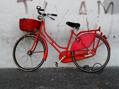 Red bicycle (soilse) Tags: red italy wall cycling grafitti basket lock rusty cycle oldfashioned 2010 emiliaromagnbicycle