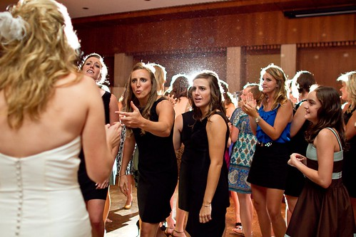 Apparently my bridesmaids did not appreciate my over-shot bouquet toss!! This is probably the funniest and one of my favorite pictures from the night. I laugh every time I look at it!