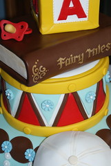 BAby Shower CAke (SugarlumpCakery) Tags: from baby 3 cake ball toy shower book cow sticks with tales drum sneakers made fairy cap prints tiered