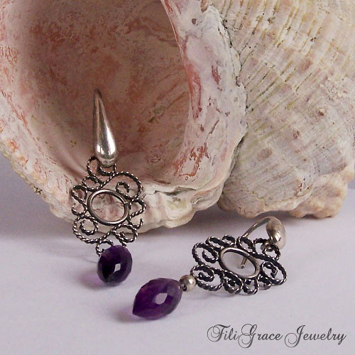 Lacy silver earrings with amethysts