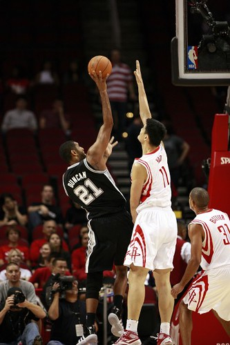 October 7th, 2010 - Yao Ming elevates to try to block Tim Duncan's shot in a pre-season match-up