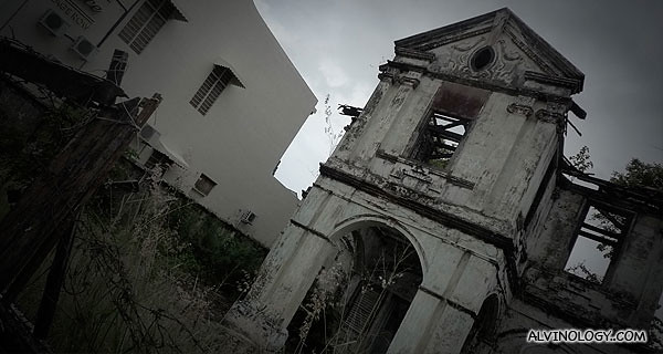 A dilapidated house in the process of being torn down