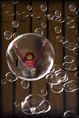 tiff in a bubble! (Black Cat Photos) Tags: uk portrait england blackcat fun photography fly flying photo movement europe sill bradford action sunday performance move m lookup falling bubble perform tiff 2010 messingabout blowingbubbles havingalaugh playday verysilly abstractportrait photocamp blackcatphotos bradfordphotocamp