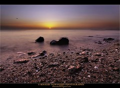 Romantic Sunrise (khalid almasoud) Tags: light sunrise canon wonderful eos hope rocks flickr all photographer  beam rights estrellas romantic kuwait  khalid reserved beache    50d   photographyrocks almasoud  thebestofday gnneniyisi