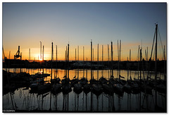 Catania - Sunset over the NIC yacht club (ciccioetneo) Tags: italy club port reflections boats italia angle harbour wide sigma sicily nic 1020mm catania sicilia yatch ciccioetneo