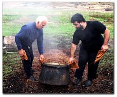 "Emptying the ""kazani"" (Eirini Papadaki) Tags: spirit greece grapes copper distillery cyclades naxos raki distiller distillation apeiranthos tsipouro kalymnios azalas pomace φωτιά παράδοση strofilia ancienttradition τσίπουρο kazani tsikoudia σταφύλια ρακί καζάνι ελλάσ νάξοσ κυκλάδεσ απείρανθοσ κεραμικό χάλκινο kalimnios τσικουδιά noulas αλκοολ απόσταξη mustresidue rakitzo αζαλάσ στροφιλιά ρακιτζό χατζάνια χατζανέματα λαινι μπιρμπινίτσα πούμα νουλάσ michalisprotonotarios καλυμνιόσ μιχάλησπρωτονοτάριοσ ζύμωση hatzania hatzanemata"