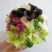 Lavender roses, green cymbidium orchids, Schwartzwalder mini calla lilies